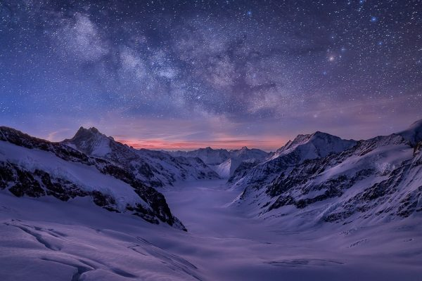 A magic night over the Pennine Alps with the milky way and Aletsch glacier in Switzerland.