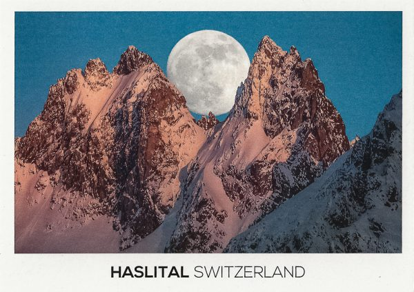 Full moon rising in the Haslital Area in the alps of Switzerland.