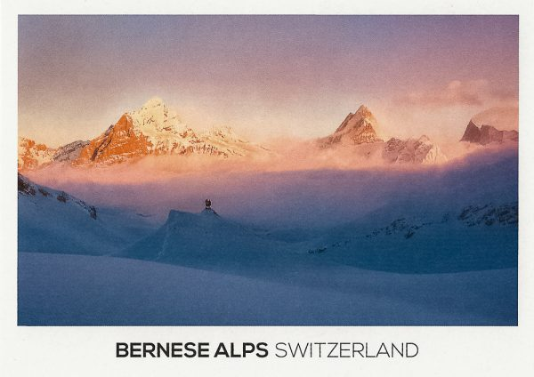 People watching the winterly mountain landscape in the Bernese Alps.