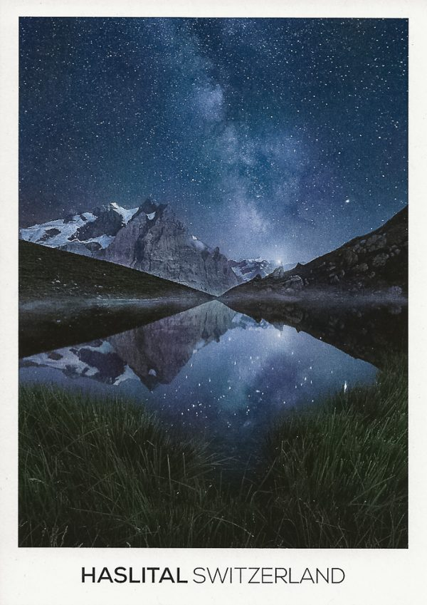 The milky way rising over an alpine lake in the Bernese Alps.