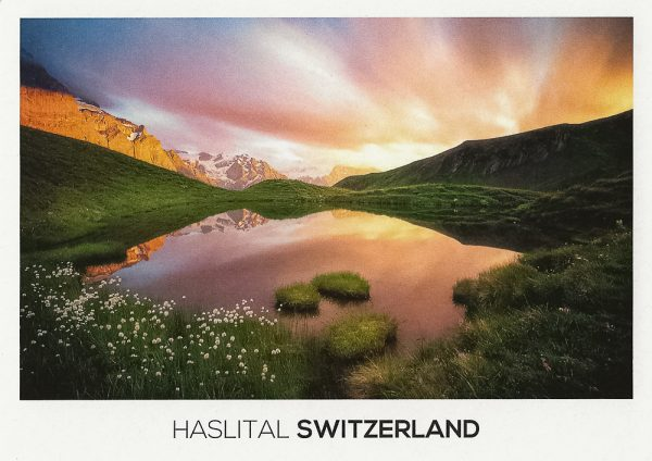 An epic sky over the mountains and an idyllic alpine lake in the Haslital Area.