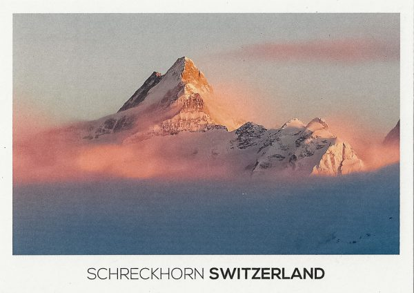 The Schreckhorn Mountain in the Bernese Alps at sunset.